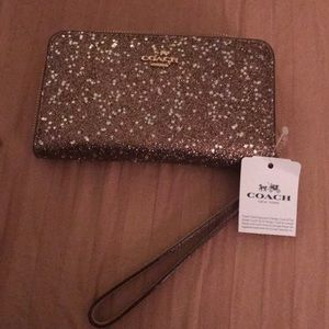 Coach glittery star wristlet with wallet inside
